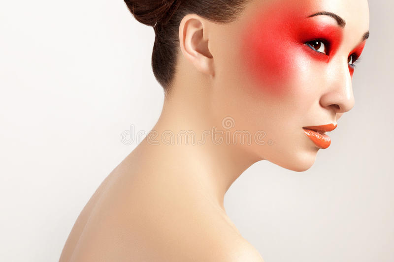 Beautiful Woman With Red Makeup and Red Lips. Fashion Makeup royalty free stock images