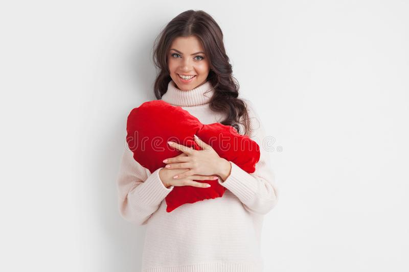 Woman with pillow heart stock photography