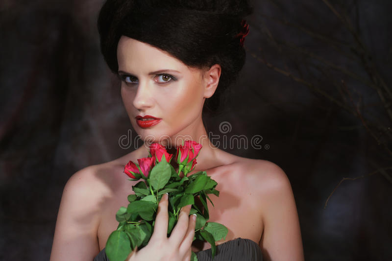 Beautiful Woman With Red Roses. royalty free stock images