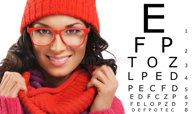 Beautiful woman with red scarf, hat and glasses. Over test vision table royalty free stock photo