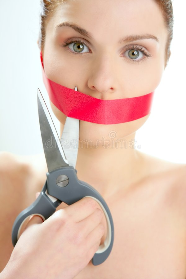 Beautiful woman with red tape on mouth portrait stock photo