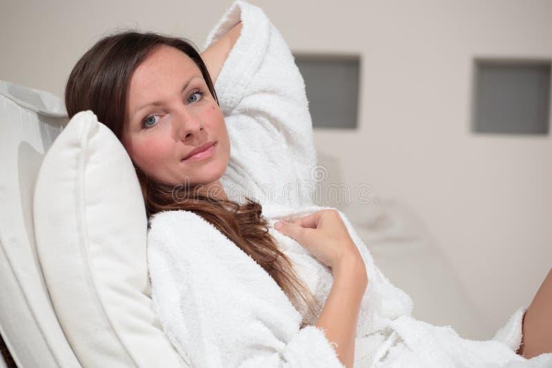 Beautiful woman relaxing. Young beautiful woman relaxing in spa / home royalty free stock image