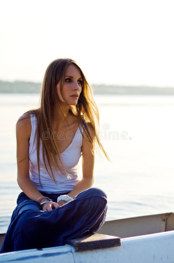 Beautiful woman relaxing in the boat royalty free stock image
