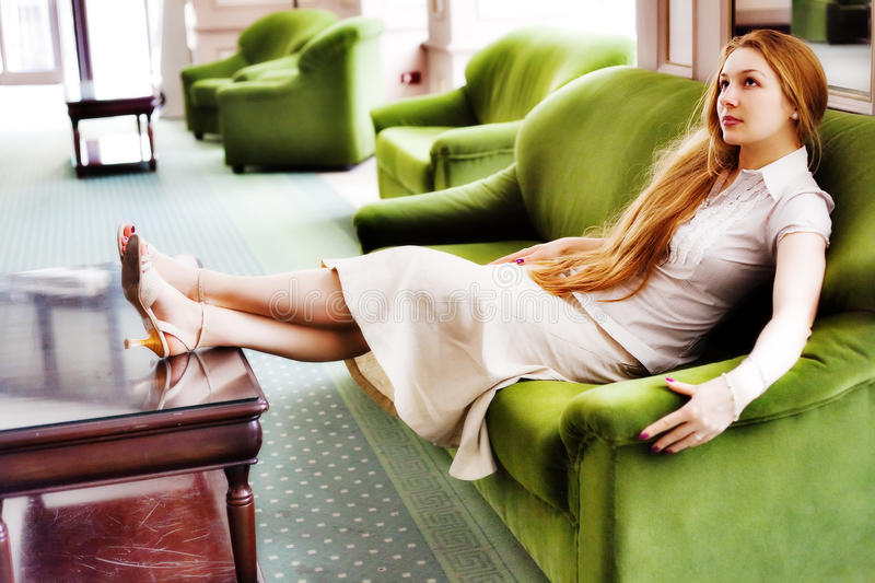 Beautiful Woman Relaxing On Comfortable Couch Royalty Free Stock Photos