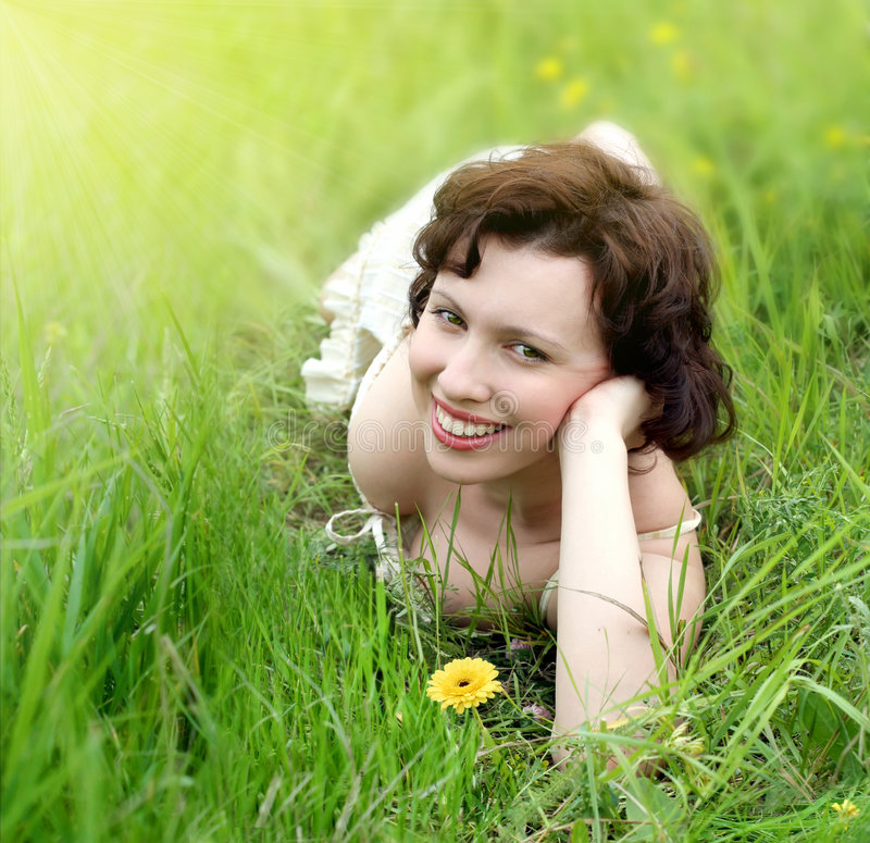 Download Beautiful Woman Relaxing In The Grass Stock Image - Image: 8305861