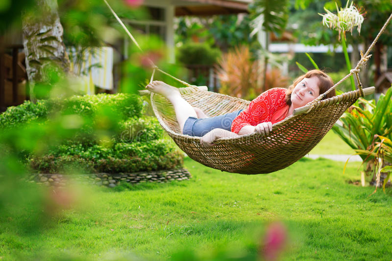 Beautiful woman relaxing in hammock royalty free stock photos
