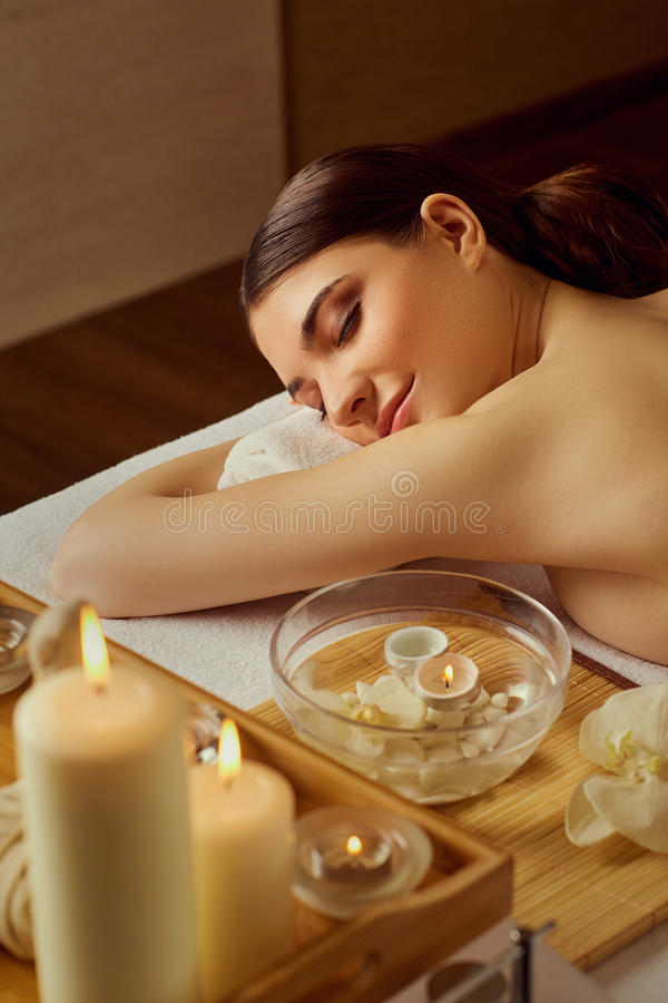 Beautiful woman relaxing lying down in spa salon royalty free stock images