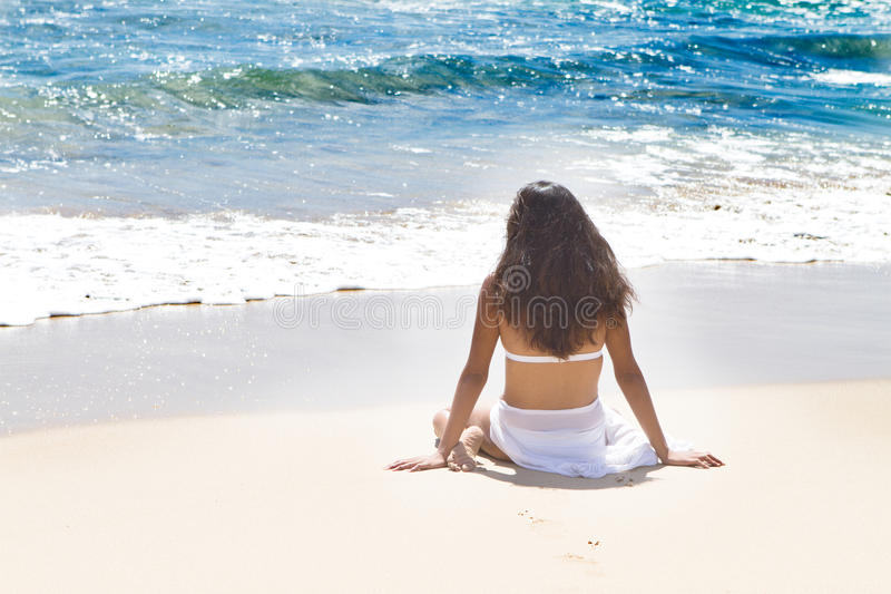 Beautiful Woman Relaxing in Paradise royalty free stock image