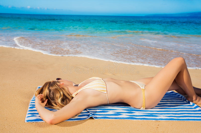 Download Beautiful Woman Relaxing On Tropical Beach Stock Photo - Image: 27328974