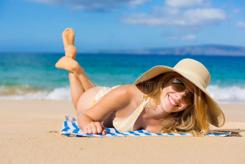 Beautiful Woman Relaxing on Tropical Beach stock image