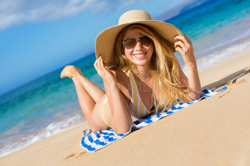 Beautiful Woman Relaxing on Tropical Beach royalty free stock images