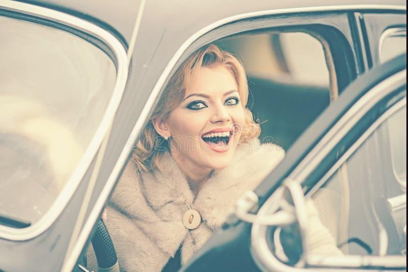 Beautiful woman in retro car. Idyllic trip. stock images