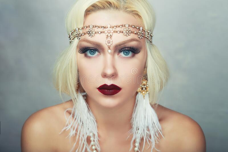 Woman retro flapper style stock photography