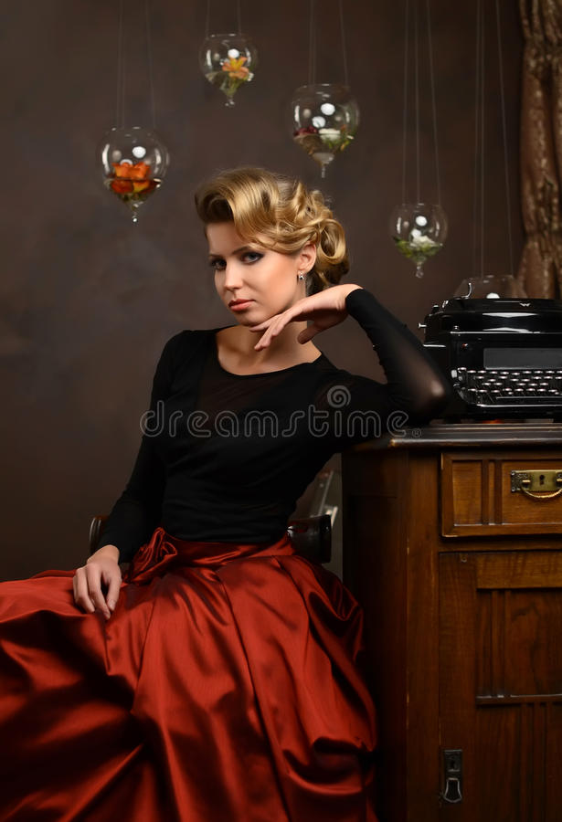 The beautiful woman in retro style royalty free stock photography