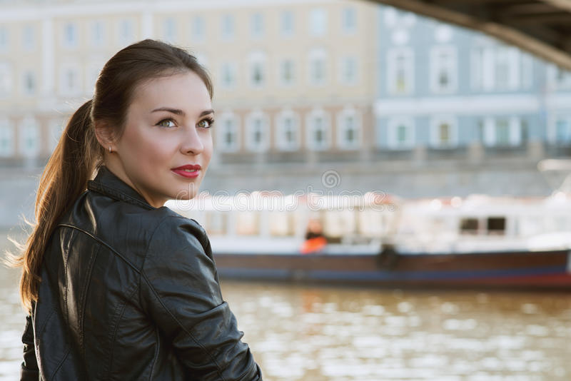 Beautiful woman at river smiles royalty free stock photography