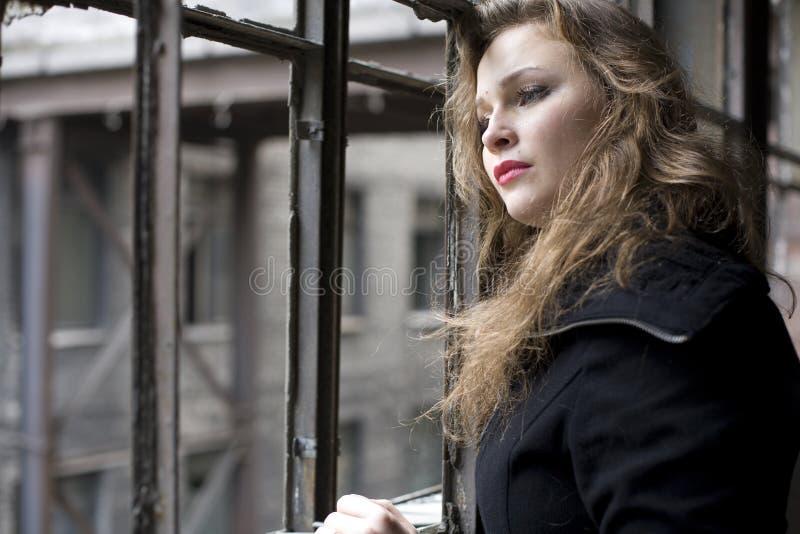 Beautiful woman in ruined building smoking. Beautiful blond woman in ruined building smoking royalty free stock photo