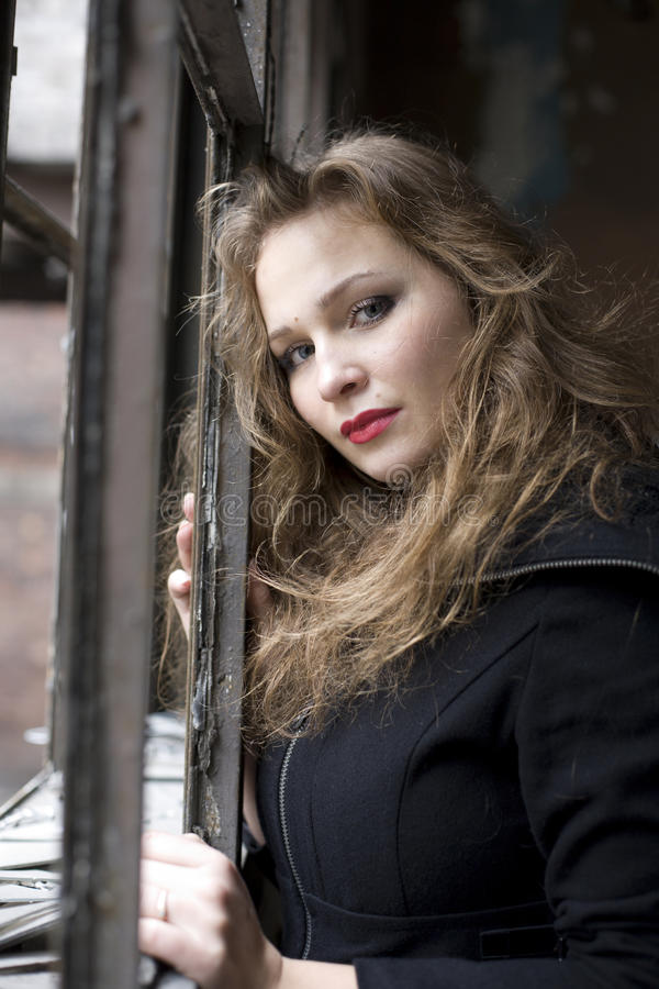 Beautiful woman in ruined building smoking. Beautiful blond woman in ruined building smoking royalty free stock photos