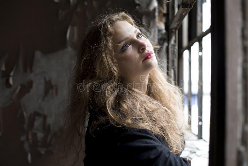 Beautiful woman in ruined building smoking. Beautiful blond woman in ruined building smoking stock photos