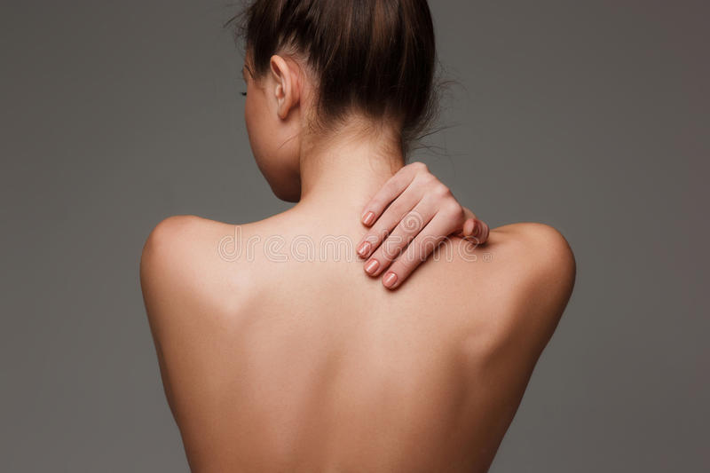 The beautiful woman`s body on gray background. The woman`s body. nude woman back on gray stock photo