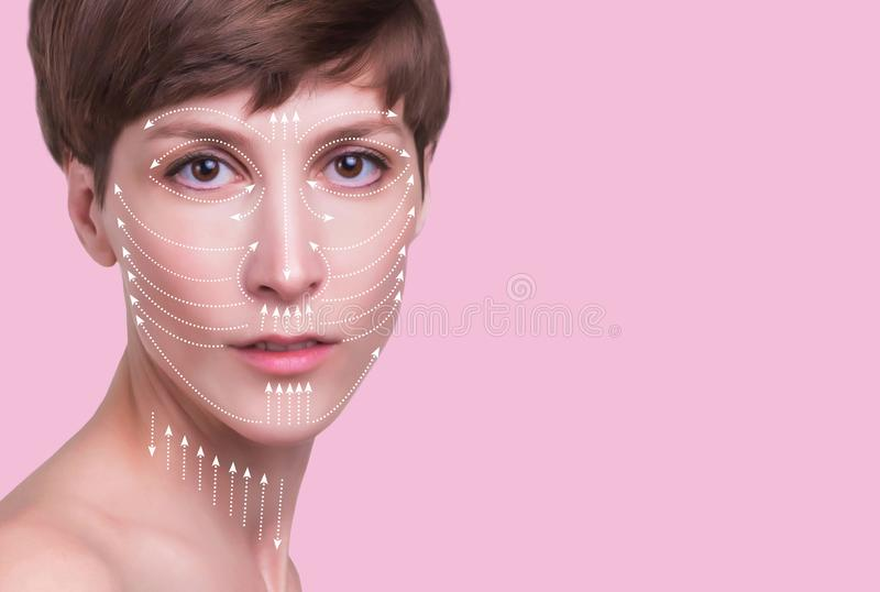 Beautiful woman`s face with massage lines royalty free stock image