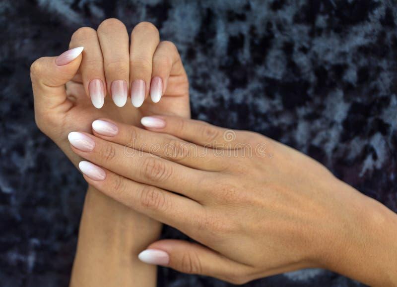 Manicure design french Ombre peach and white stock photo
