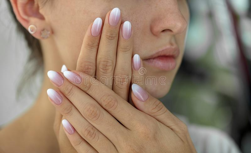 Beautiful woman`s nails with beautiful french manicure ombre stock photos