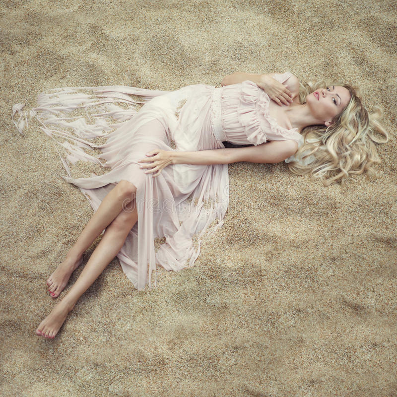 Beautiful woman on sand royalty free stock photo