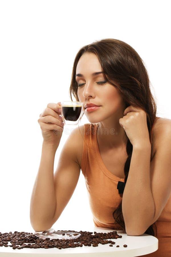 Beautiful woman scenting on espresso coffee