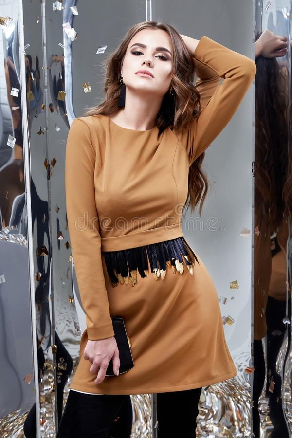 Beautiful woman lady spring autumn collection glamor model. Fashion clothes wear style for date brown short dress accessory handbag pretty face dark natural stock photo