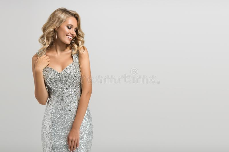 Beautiful woman in shining silver dress royalty free stock photography