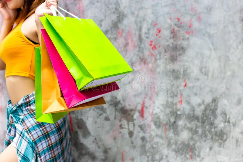 Beautiful woman is shopaholic. Gorgeous woman can not restrain, royalty free stock photography