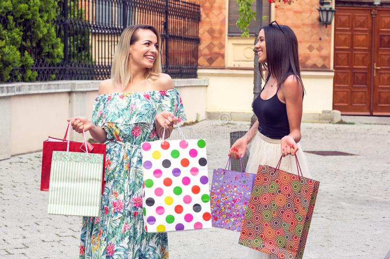 Beautiful woman with shopping bags in the city-sale, shopping, tourism and happy people concept royalty free stock photo