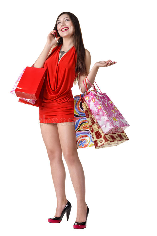 Download Beautiful Woman With Shopping Bags And Phone Royalty Free Stock Images - Image: 19332699