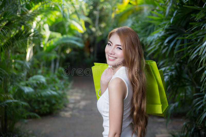 Beautiful woman with shopping bags. Beautiful young woman with shopping bags royalty free stock images