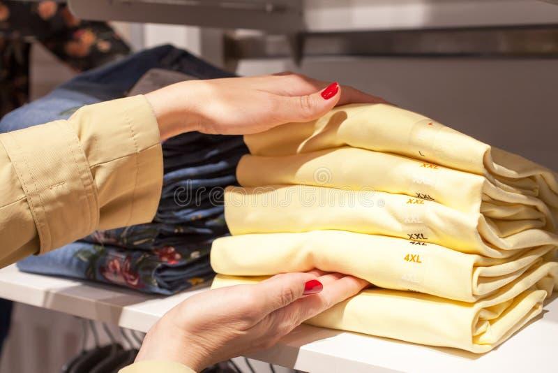 Beautiful woman shopping at fashionable shop stock photo
