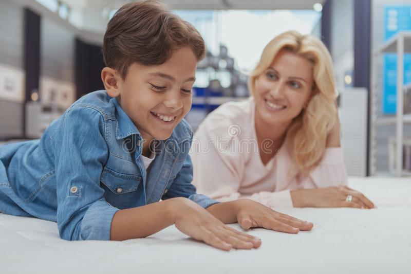 Beautiful woman shopping for furniture with her little son stock photos