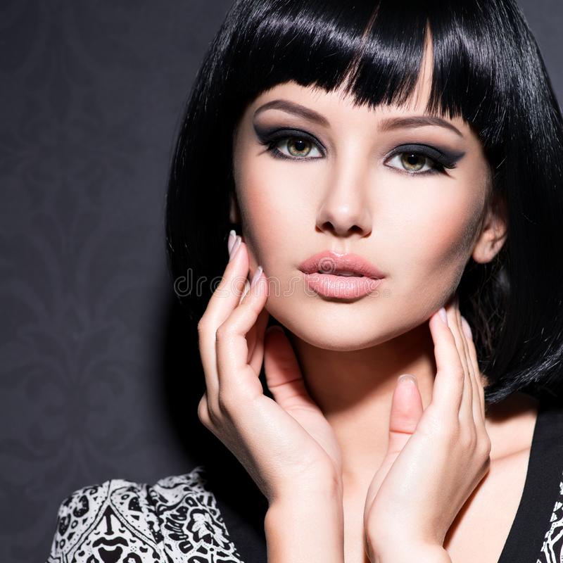 Beautiful woman with short black hair royalty free stock photo