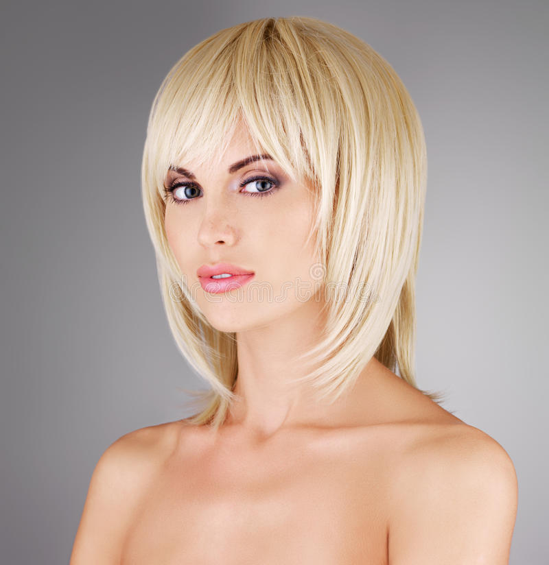 Beautiful woman with shot blond hairstyle stock photography