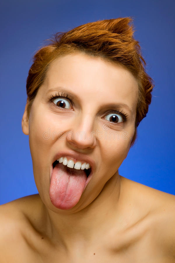 Beautiful woman showing her tongue out