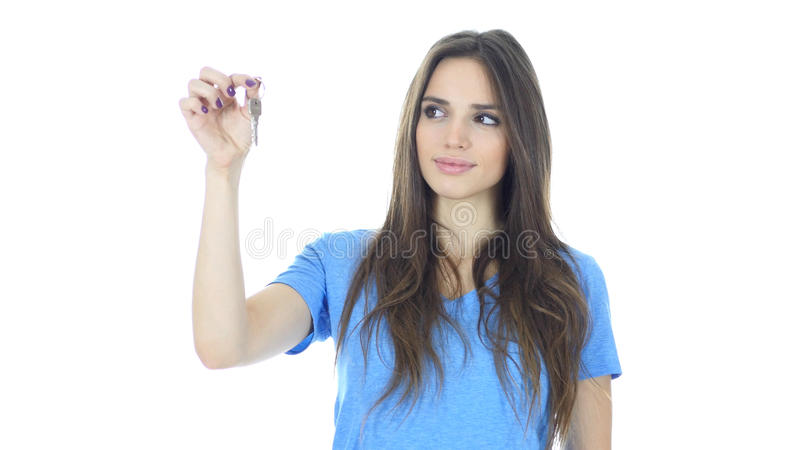 Beautiful Woman Showing Key of New House, White Background. High quality royalty free stock photo