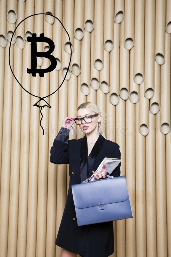 Beautiful blond woman showing standing near bitcoin sketch. Virtual money or btc crush concept. Cryptocurrency. Beautiful woman showing standing near bitcoin royalty free stock image