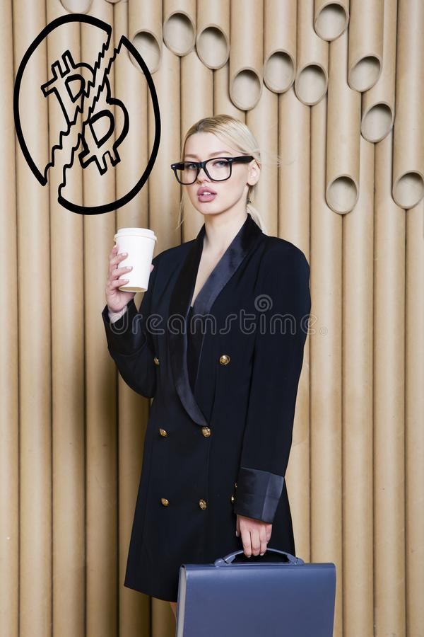 Beautiful blond woman showing standing near bitcoin sketch. Virtual money or btc crush concept. Cryptocurrency. Beautiful woman showing standing near bitcoin royalty free stock images