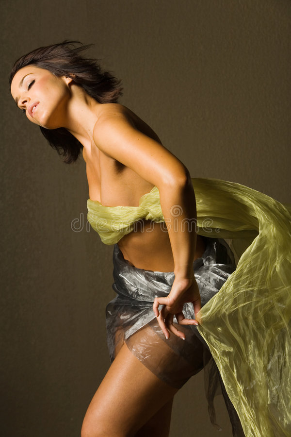 Beautiful woman in silk royalty free stock photography