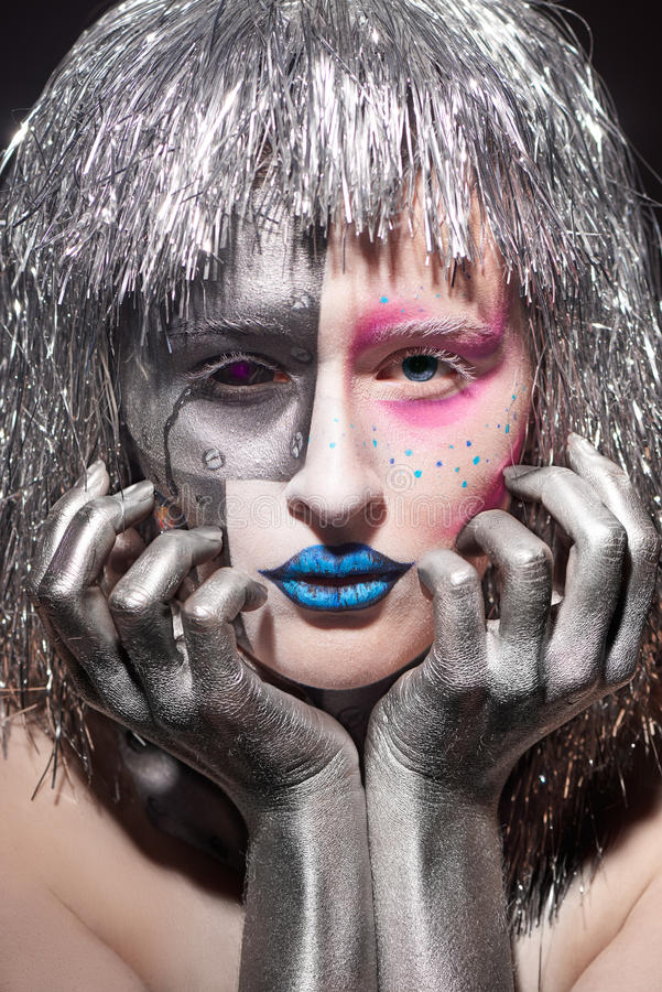 Beautiful woman with silver hair and hands. Closeup of female face with bright makeup. beautiful woman with silver hair and hands stock photo