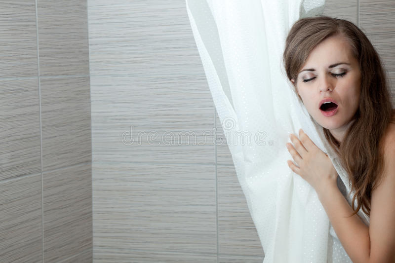 Beautiful woman singing in bathroom royalty free stock photography