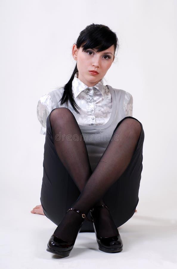 Beautiful Woman Sits Cross-legged Royalty Free Stock Photos