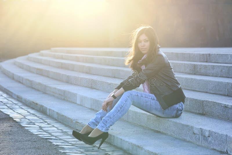 Beautiful woman sitting stock image
