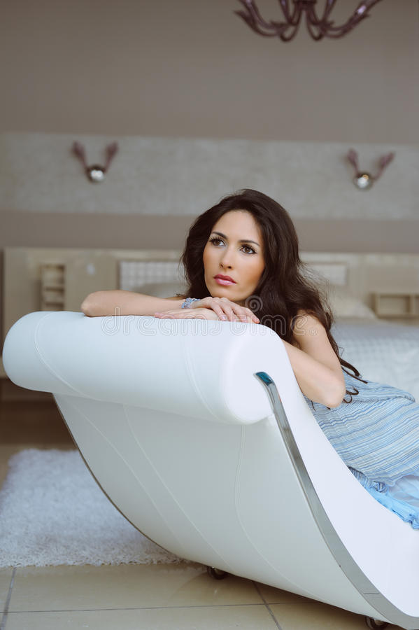 Download Beautiful Woman Sitting In A Chair And Relaxation Stock Image - Image: 19650527