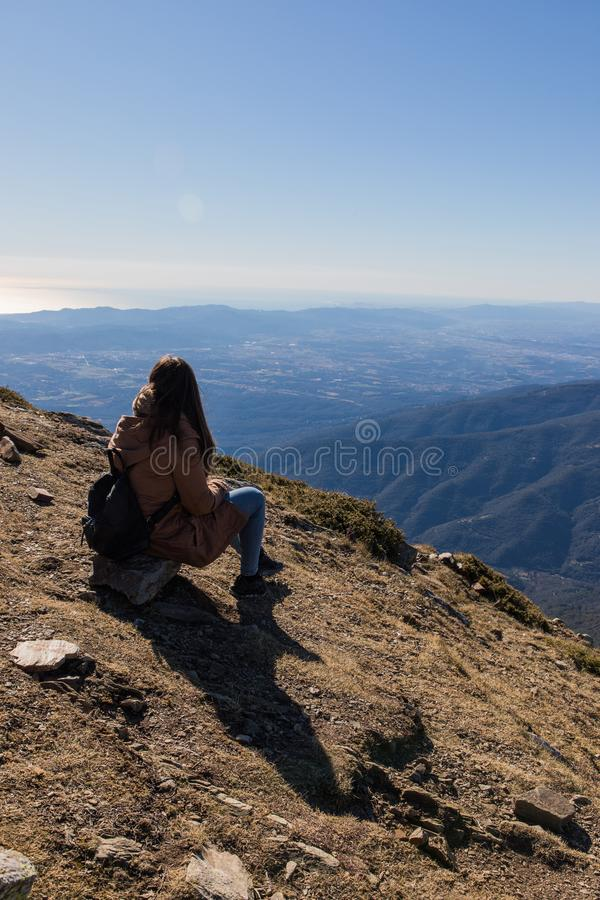 Beautiful woman sitting after hiking during winter or autumn in Catalonia (Turo del Home - Spain. ) with copy space, landscape, alpine, extreme royalty free stock photos