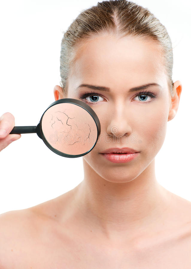 Beautiful woman, skin close up with a magnifying glass. Over a white background stock images